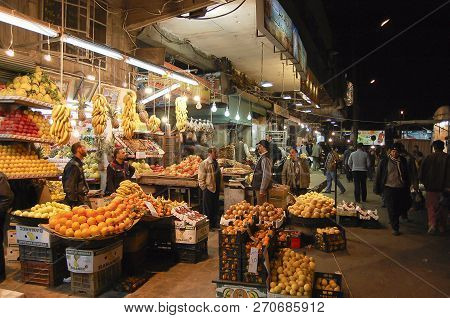 Aleppo, Syria - January 12, 2010: Popular Fruit Market In The Evening As It Was Before The Outbreak