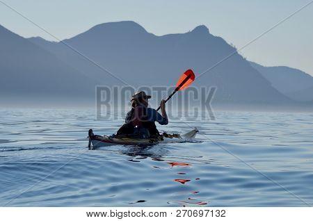Pacific Ocean, Northwestern Vancouver Island, Bc, July 22, 2018: Man Paddles Sea Kayak On Calm Summe