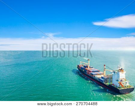 Aerial View Of Cargo Ships That Run In The Middle Of The Sea Are Transported Container To The Port.