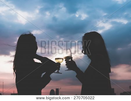Silhouette Two Asia Lesbian Lgbt Couple Toast Champagne Glass At Rooftop Party In Sunset Evening Tim