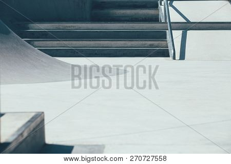 Detail Of A Ramp And The Stairs Used As Obstacles To Make Tricks In An Empty Urban Skate Park. Usefu