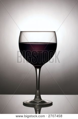 Glass Of Wine Silhouetted Against Spotlight