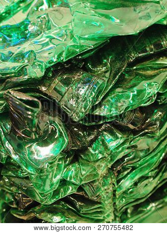 Nuremberg, Germany - November 13, 2018: Crushed Green Plastic Bottles For Recycling