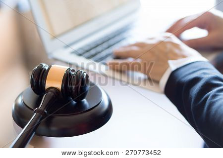 Judge Gavel And Lawyer Working On A Laptop