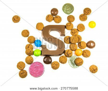Bunch Of Pepernoten Strooigoed With Chocolate Letter S, Top View On White Background For Annual Sint