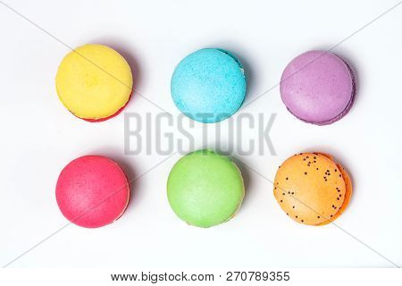 Sweet and colourful french macaroons on white background.