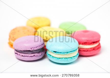 Colorful macaroons on the white background.