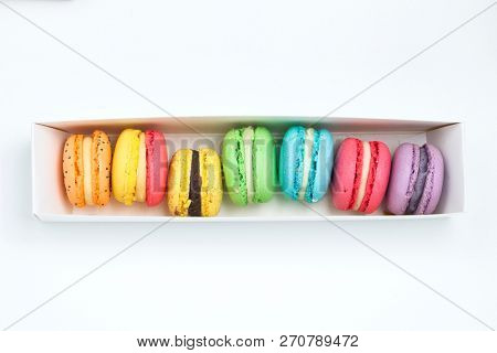 Sweet and colourful french macaroons in white box.