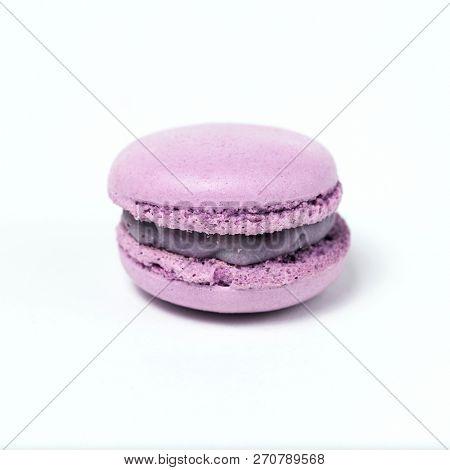 Sweet purple macaroon isolated on white background.