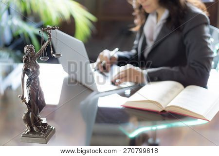 Lawyer Office. Statue Of Justice With Scales And Lawyer Working