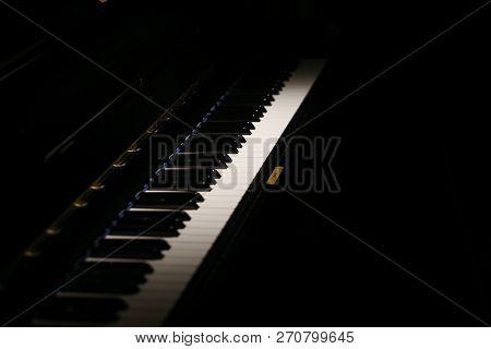 Piano Keys Of A Classic Piano In The Dark
