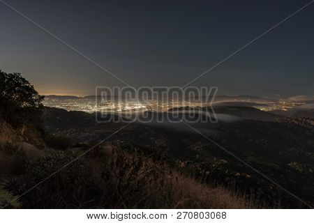 Hilltop view of fog pouring over the Santa Susana Pass in the San Fernando Valley area of Los Angeles, California.  Shot from Rocky Peak Mountain Park near Simi Valley.
