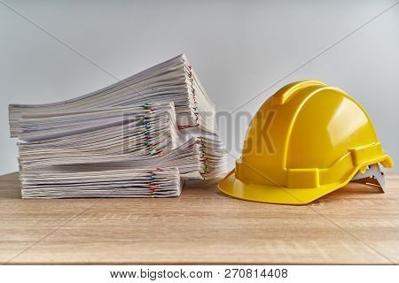 Pile Overload Document Of Report With Yellow Engineer Hat