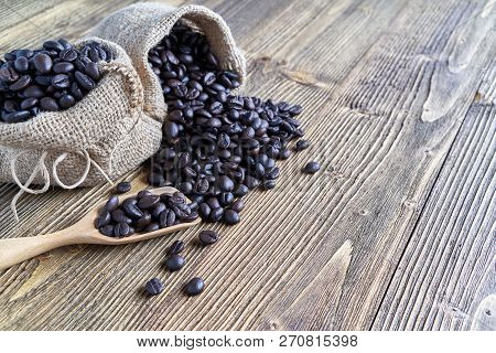 Close Up Stack Of Coffee Bean On Wooden Spoon