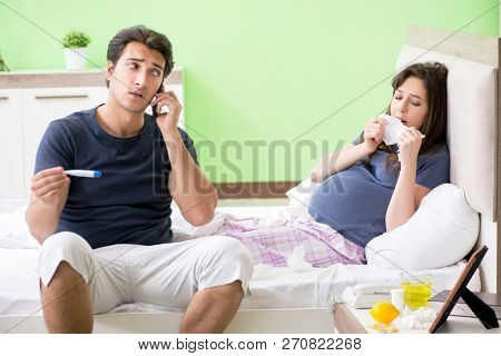 Young husband looking after his pregnant wife