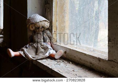 Doll On Windowsill In Abandoned Kindergarten In Destroyed Village Of Kopachi, Chernobyl Npp Exclusio