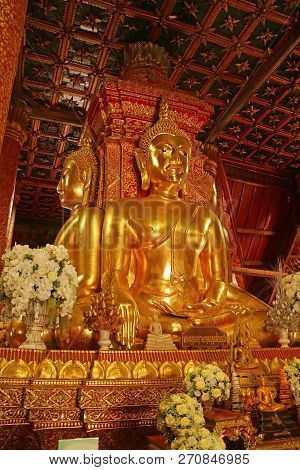 Vertical Photo Of Golden Four-sided Seated Buddha Images In Wat Phumin Temple, Nan Province, Thailan