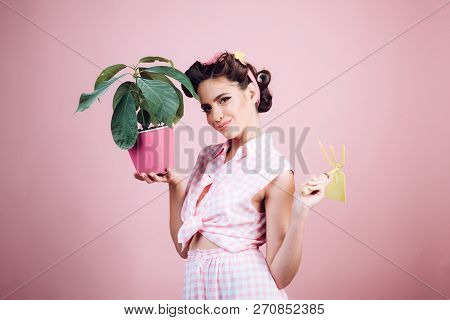 Taking Care For Environment. Greenhouse Worker Or Gardener. Pin Up Woman With Trendy Makeup. Spring.