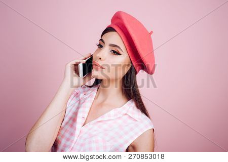 French Girl With Phone. Parisian Lady. Pinup Girl With Fashion Hair. Pin Up Woman With Trendy Makeup
