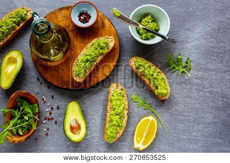 Avocado Toasts And Ingredients Flat Lay. Good Fats Raw Healthy Eating Concept.