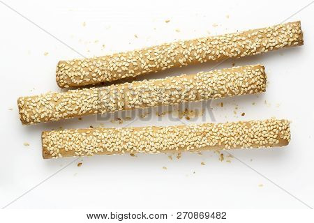 Bread Sticks With Sesame Seeds On White