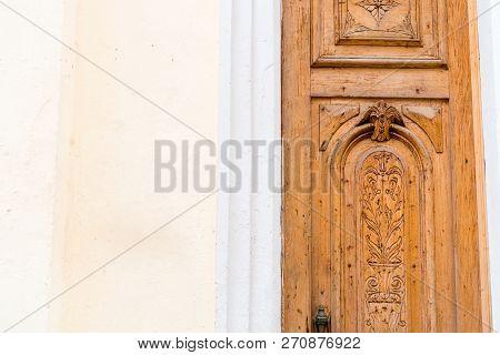 Old Wooden Door With Paint And Decrepit Colored Facade In Havana