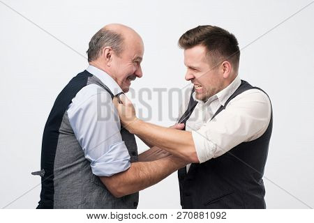 Business Competition And Confrontation Concept. Two Men Are Fighting For Job