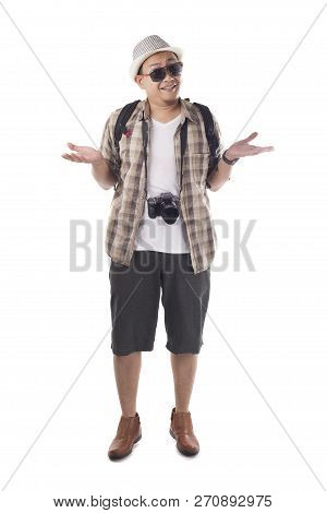 Traveling People Concept. Portrait Of Asian Male Backpacker Tourist Wearing Hat, Black Sunglasses, C