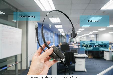 Close Up Woman Hold Headset For Callcenter, Telemarketing And Business Conference In Office