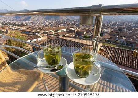 Cups Of Coca Tea With View Of Cusco City In Peru. It Is A Traditional Tea For Fighting Altitude Sick