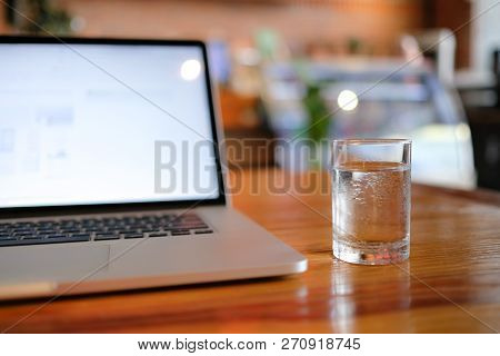 A Cup Of Pure Water With Laptop On Table. Royalty High Quality Free Stock Image Of Glass Of Pure Wat