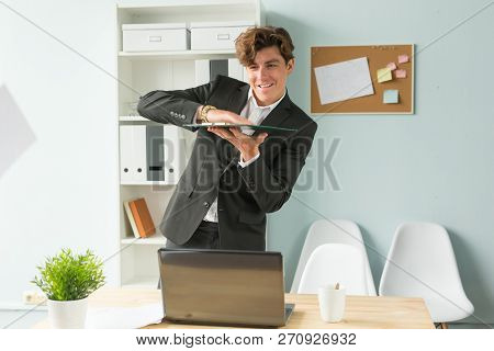 Business, Humor And People Concept - Handsome And Young Man In Suit Throws Up Sheets Of Paper In Off