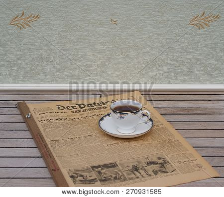 English Teacup And Saucer On An Old German Daily Newspaper Der Patriot, Edition From 8. June 1950 Ka