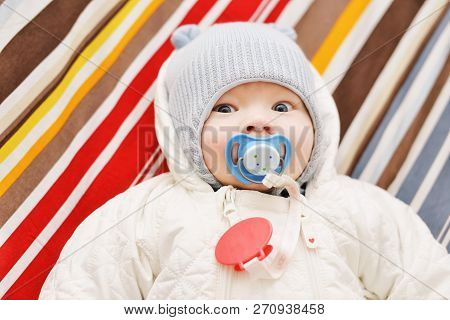 Newborn Baby Wearing Overall And Hat, Ready For Winter