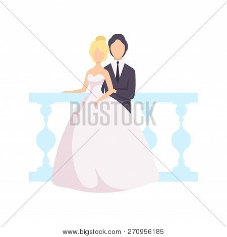 Elegant Couple Of Newlyweds Posing For Photo Against The Backdrop Of A Balustrade At A Wedding Cerem