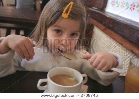 Toddler Eating Soup With A Spoon