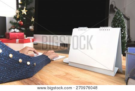Businesswoman With Calendar Planner And Computer Screen In Christmas Holiday At The Office With Chri