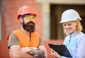 Safety inspector concept. Woman inspector and bearded brutal builder discuss construction progress. Construction project inspecting. Construction site safety inspection. Discuss progress project poster