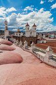 Roof of Templo Nuestra Senora de la Merced church in Sucre, capital of Bolivia. Convento de San Felipe Neri behind. poster