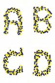 Collection of letter ABCD alphabet made of medical capsules style poster
