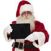 portrait of happy saint nick presenting blank pad screen while standing on white background poster