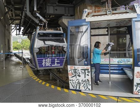 Kowloon, Hong Kong, May 2018 - View Of The Ngong Ping 360 Cable Cars Being Cleaned At The Station, L
