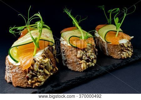 Fresh Bruschetta With Shrimp, Cheese, Ham And Microgreens