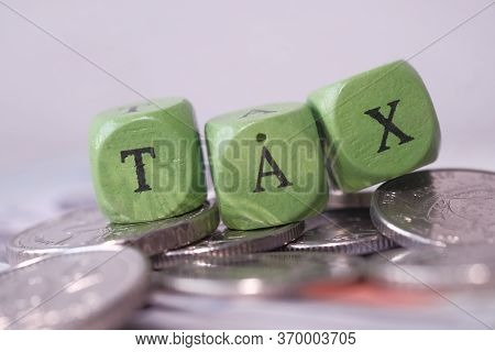 The Concept Tax Payment. Tax Word On Wooden Block