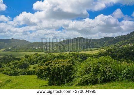 Scenic View Over Peaceful Green Prairies And Fields From The Top Of A Mountain In Martinique West In