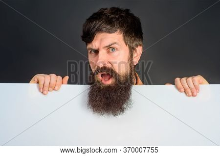 Copy Space. Advertising. Confused Man With Blank Board. Space For Text. Bearded Man Holds Empty Boar