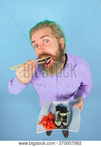 Sushi. Japan. Sushi Delivery. Japanese Food. Bearded Man With Plate Of Sushiroll. Man Eating Sushi.