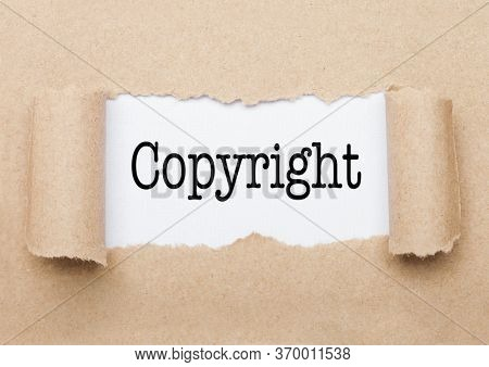 Copyright Concept Text Appearing Behind Torn Brown Paper Envelope
