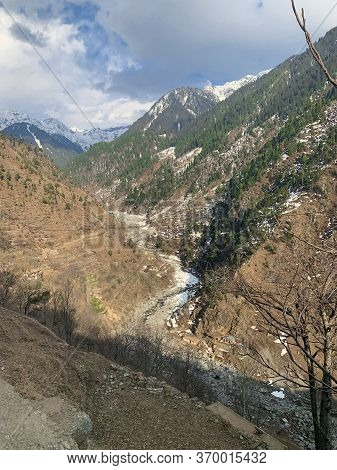 Rived Down At The Hollow Between Mountains At The Swat Valley. View From The Mountain.