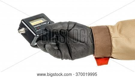 Satellite Finder In Electrician Hand In Black Protective Glove Isolated On White Background